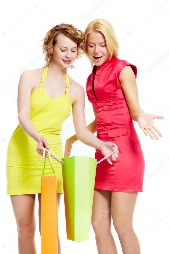 Young female showing gift to her friend — Stock Photo #13723988