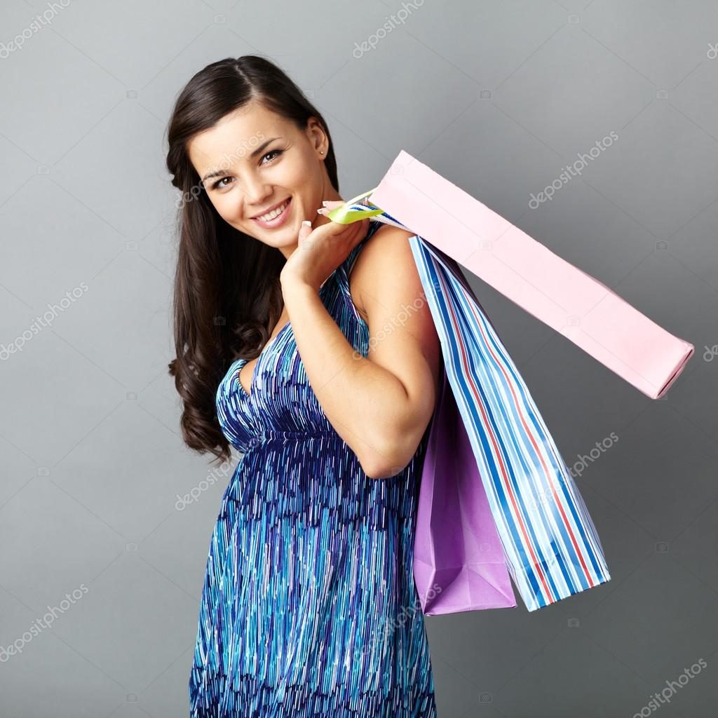 Portrait of happy brunette with paperbags after shopping — Stock Photo #13724163