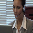 Businesswoman with headset is talking using IP telephony - Zdjęcie stockowe