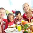 Family by festive table — Stock Photo
