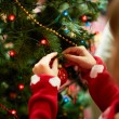 Decorating xmas tree — Stock Photo #16042761