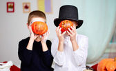 Pumpkin-faced boys — Stock Photo