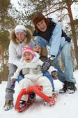 Family on sledge — Stock Photo