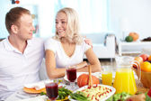 Couple by festive table — Stock Photo