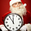 Santa with clock — Stock Photo