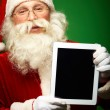 Santa with touchpad — Stock Photo #16053379