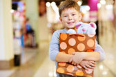 Child with gift — Stock Photo
