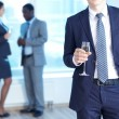 Businessman with champagne — Stock Photo