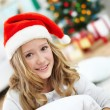 Girl in santa cap — Stock Photo #17139421