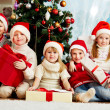 By Christmas tree — Stock Photo #17139517