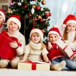 By Christmas tree — Stock Photo