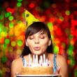Stock Photo: Blowing on candles