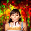 Blowing on candles - Stock Photo