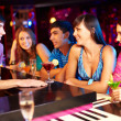 Friends in bar — Stock Photo #17142827
