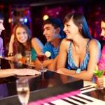 Friends in bar — Stock Photo