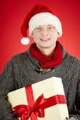 Guy with present — Stock Photo