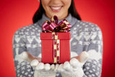 Gift on hands — Stock Photo