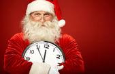 圣诞老人与时钟 — 图库照片