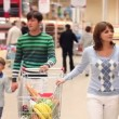 Family in supermarket - Stock Photo