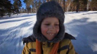 Boy on sledge — Stock Video