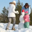Making a snowman — Vídeo de stock