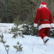 Santa pulling sled - Stock Photo