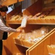 Buying bakery products - Foto de Stock