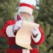 Santa writing letter - Stock Photo