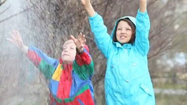 Children having fun in rainy weather