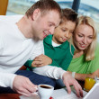 Stock Photo: Family with laptop