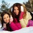 Stock Photo: Girls in snowdrift