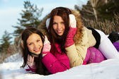 Girls in snowdrift — Stock Photo