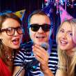 Singing at party — Stock Photo