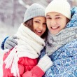 Couple in winter park — Stock Photo #19223521