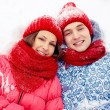 Lying on snow — Stock Photo