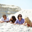 Friends on sand — Stock Photo