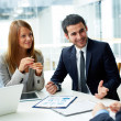 Business partners discussing documents — Stock Photo #21186915
