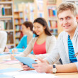 Foto de Stock  : Student in library