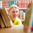 Stock Photo: Peeking out of books