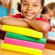 Kid with books — Stock Photo #21187799