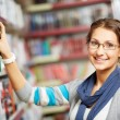 Choosing book — Stock Photo #21188263