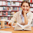Young girl in library — Stock Photo #21188267