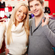Couple of shopaholics — Stock Photo #21189827