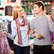 Couple in clothes department — Stock Photo #21189849