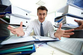 Overloaded with paperwork — Stock Photo