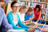 Studying in library — Stock Photo