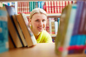 Peeking out of books — Stock Photo