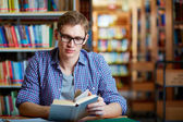 Guy reading — Stock Photo
