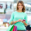 Texting shopper - Stock Photo