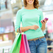 Girl with purchases - Stock Photo